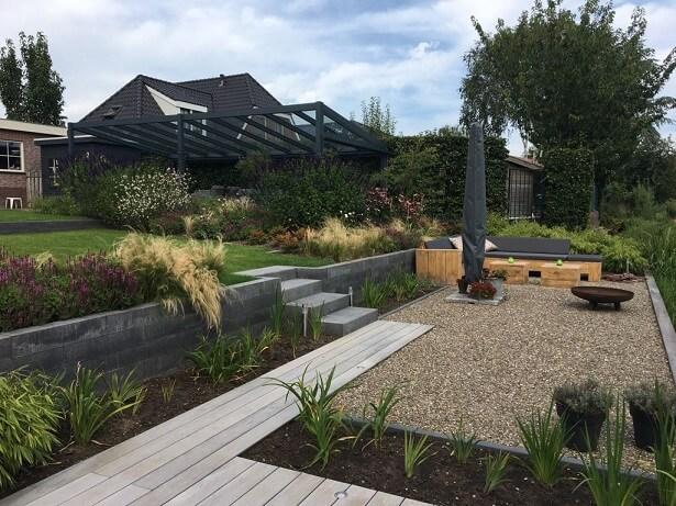 tuinontwerp terras aan water hoogteverschil